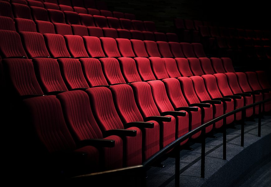 Rows of red seats in a theater by rawpixel com